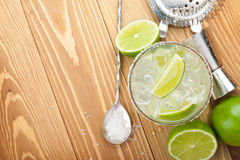 Classic margarita cocktail with salty rim on wooden table Stock Images