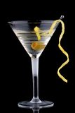 Classic martini - Most popular cocktails series. Classical martini in chilled glass over black background on reflection surface, garnished with olive and lemon Royalty Free Stock Photos