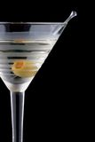 Classic martini - Most popular cocktails series. Classical martini in chilled glass over black background on reflection surface, garnished with olive. Most Stock Photo