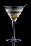 Classic martini - Most popular cocktails series. Classical martini in chilled glass over black background on reflection surface, garnished with olive. Most Stock Images