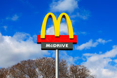 Classic McDonald's sign with blue sky Stock Images