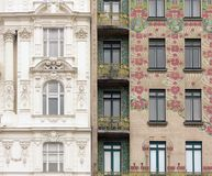 Classic meets Art Nouveau in Vienna, Austria. Two different style house facades next to each other Stock Photo
