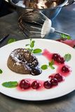 Classic chocolate fondant with cherries Royalty Free Stock Photos