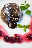 Classic chocolate fondant with cherries Royalty Free Stock Images