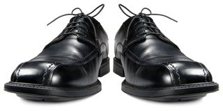 Classic men black club shoes isolated closeup Stock Photo