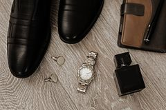 Classic men`s accessories. Shoes with perfume Stock Image