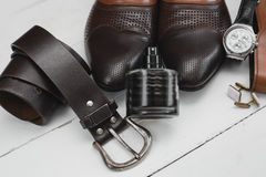 Classic men`s accessories. Shoes with belt and perfume Royalty Free Stock Images