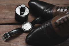 Classic men`s accessories. Shoes with perfume and watch Royalty Free Stock Images