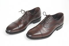 Classic men`s brown Oxford shoes on white background. Leather sh