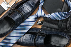 Classic men's shoes, tie, cufflinks, gloves, belt, purse on the Royalty Free Stock Photo