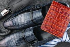 Classic men's shoes, tie, wallet, umbrella on the wooden floor Stock Image