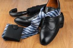 Classic men's shoes, tie, wallet, umbrella on the wooden floor, Stock Images