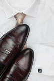 Classic men's shoes, tie on a white shirt Stock Image