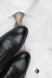 Classic men's shoes, tie on a white shirt. Classic men's shoes, tie on a white shirt, with place for your text Stock Photo