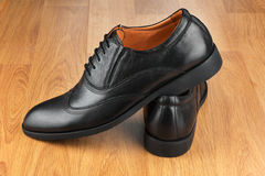 Classic men's shoes,  on the wooden floor Royalty Free Stock Photo