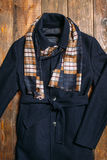 Classic men's wool coat and warm scarf. Stock Photo