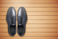 Classic Men Shoes on wooden background Stock Photo