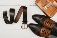 Classic mens accessories. Shoes with handbag and belt Stock Photos