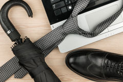 Classic mens black shoes,notebook, tie, umbrella lies on desk. Classic mens black shoes, notebook, tie, umbrella lies on desk. View from above Royalty Free Stock Photo
