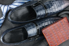 Classic mens blue shoes, tie, umbrella, purse on natural leather. Can be used as background Royalty Free Stock Photo