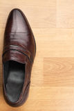 Classic mens shoes stand on the wooden floor Stock Photos