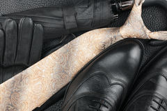 Classic mens shoes, tie, gloves, umbrella on natural skin Stock Photo
