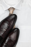 Classic mens shoes, tie on a white shirt Royalty Free Stock Image