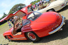 Classic mercedes sports car and cabin Royalty Free Stock Images