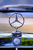 Classic Mercedez-Benz Hood Ornament. Classic Mercedes-Benz three-pronged star emblem hood bonnet ornament isolated with shallow depth of field Stock Images