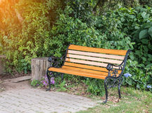 Classic metal bench with the sunlight. Stock Photography