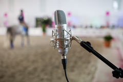 Classic metal microphone. On a horse competition indoors, Spain Stock Images