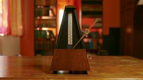 Classic Metronome Clicking. In warm toned light stock footage