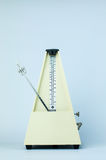 Classic Metronome. Classic Yellow Metronome in White Isolated Background Stock Image