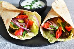 Classic Mexican cuisine. Tacos with beef, avocado, chili and tomatoes. stock images