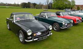 Classic MG B motor cars parked on grass. Stock Images