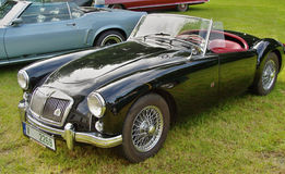 Classic MG sports car. Antique, convertible MG sports car with the top down Stock Photos