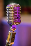 Classic microphone. In color lighting Stock Images