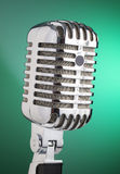 Classic microphone. Isolated on green background Stock Photos
