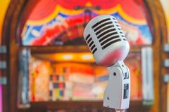 Classic microphone. On colorful blur background Stock Images