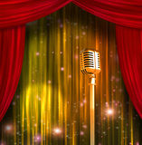 Classic Microphone with Colorful Curtains Royalty Free Stock Images