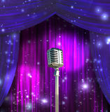 Classic Microphone with Colorful Curtains Stock Photo