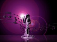 Classic microphone with pink lighting Royalty Free Stock Photos