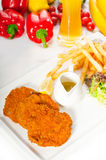 Classic Milanese veal cutlets and vegetables Royalty Free Stock Images