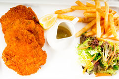 Classic Milanese veal cutlets and vegetables Royalty Free Stock Photo
