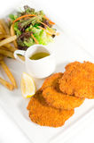 Classic Milanese veal cutlets and vegetables stock photo