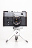 Classic 35mm old analog camera on tripod Royalty Free Stock Photography