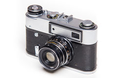 Classic 35mm old analog camera on white Royalty Free Stock Photography