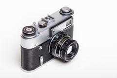 Classic 35mm old analog camera on white Royalty Free Stock Photo