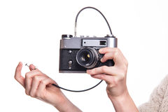 Classic 35mm photo camera in hand Stock Photography