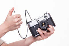 Classic 35mm photo camera in hand Stock Image